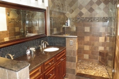Bathroom with custom, Cambria countertop, riverstone shower floor