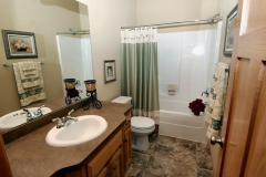 Bathroom with laminate countertop, tile floor
