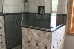 Custom tiled shower with glass enclosure