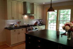 Kitchen island in black with soapstone top