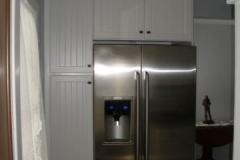 Storage pantry around refrigerator