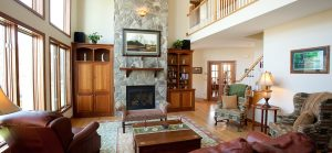 Great room with stone fireplace.